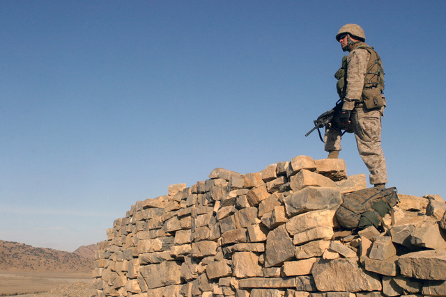 US Marine Corps (USMC) Lance Corporal (LCPL) Cody Hendricks, a Rifleman with Weapons Company, 3rd Battalion, 3rd Marine Regiment, provides security for soldiers of Fox Battery, 7th Field Artillery during a training exercise in the vicinity of Khowst Afghanistan (AFG), in support of Operation ENDURING FREEDOM