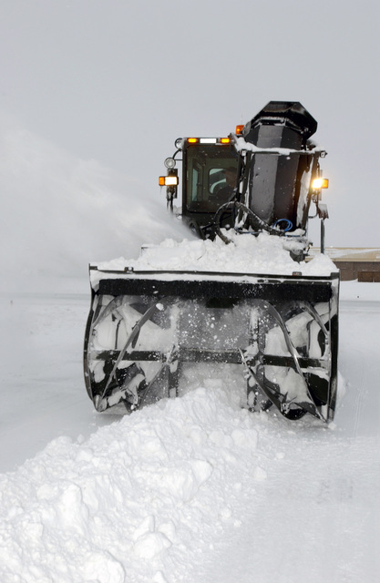 Donny Barr, a heavy equipment operator from the 92nd Civil Engineer Squadron,  uses an Osh Kosh Multi-Purpose Snow Remover to remove snow from the warm up pad area of the flight line at Fairchild Air Force Base, Wash., on Jan. 10, 2005. The snow remover has a 575 horsepower diesel engine and it removes 3000 tons of snow per hour. (USAF PHOTO by AIRMAN 1ST Class Clay Lancaster) (Released)