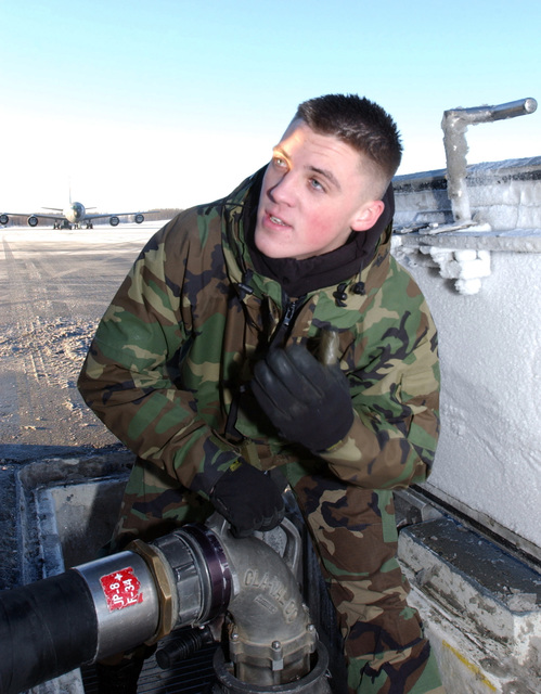 U.S. Air Force SENIOR AIRMAN Troy Criss, a fuels distribution technician from the 3rd Logistics Readiness Squadron, sets up a hydrant servicing vehicle at the flight line at Elmendorf Air Force Base, Alaska, on Jan. 10, 2005. (USAF PHOTO by STAFF SGT. Prentice Colter) (Released)