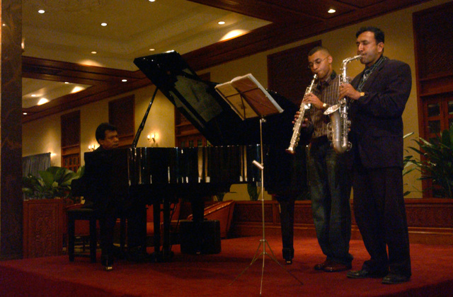 U.S. Air Force SENIOR AIRMAN David Collins (center), a member of the 33rd Aircraft Maintenance Unit, Kadena Air Base, Japan, spends his downtime entertaining guests by playing the soprano saxophone with local musicians at the Trans Asia Hotel at Colombo, Sri Lanka, during Operation Unified Assistance on Jan. 13, 2005. More than 18,000 U.S. military personnel are providing humanitarian assistance in Southwest Asia after a 9.0 magnitude earthquake on Dec. 26, 2004, triggered devastating tsunamis that killed over 250,000 people in the region. (USAF PHOTO by STAFF SGT. Chenzira Mallory) (Released)