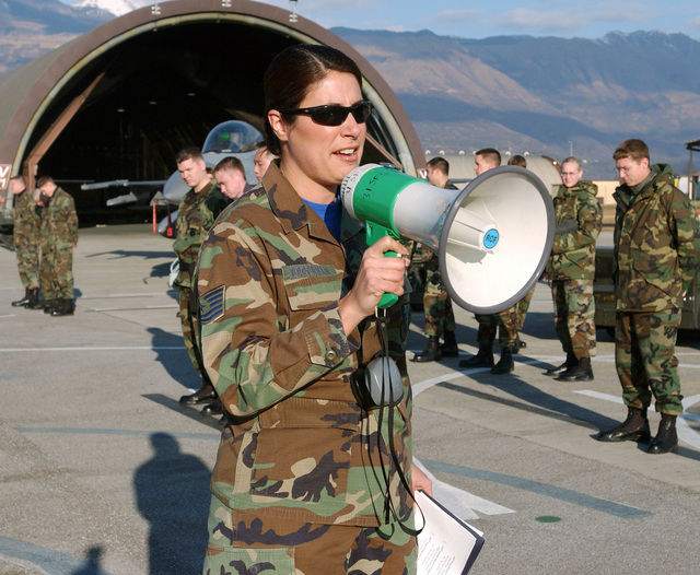 U.S. Air Force 31st Maintenance Operations Squadron 31st Fighter Wing Weapons Academic Instructor TECH. SGT. Natalie Brockman, gives a safety briefing using a megaphone to participants of the 31st Aircraft Maintenance Squadron Annual Weapon Load Competition at Aviano Air Base, Italy, on Jan. 14, 2005. (U.S. Air Force PHOTO by AIRMAN 1ST Class Scherrie K. Gates)  (Released)