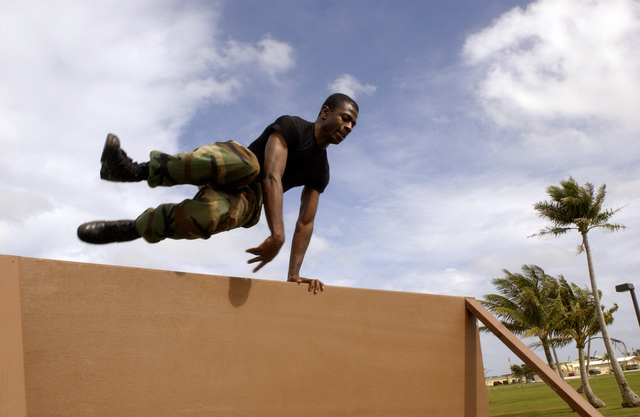 U.S. Air Force 36th Communications Squadron SENIOR AIRMAN Christopher Berry jumps over a wall during Warrior Challenge Day at Arc Light Memorial Park, Andersen Air Force Base, Guam, on Jan. 14, 2005. (U.S. Air Force PHOTO by AIRMAN Teresa M. Pumphrey) (Released)