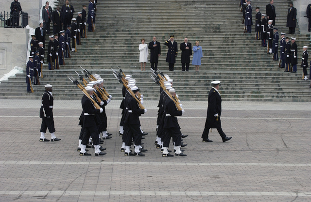 Members of the US Navy (USN) Ceremonial Honor Guard pass in review at the East Front of the US Capitol during the 2005 Presidential Inaugural. The USN Ceremonial Guard provides military ceremonial support to the 55th Presidential Inauguration. More than 5,000 men and women in uniform provide military ceremonial support to the Presidential Inauguration, a tradition dating back to George Washington's 1789 Inauguration. Receiving the honors are US President George W. Bush and First Lady Laura Bush (left) and Vice President Dick Cheney and his wife Lynne (right)