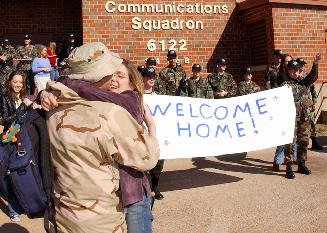 U.S. Air Force 7th Communications Squadron commander LT. COL. William Robinson is welcomed home by his wife after a 7-month deployment, at Dyess Air Force Base TX., on Jan. 20, 2005. (U.S. Air Force PHOTO by SENIOR AIRMAN Araceli Alarcon) (Released)