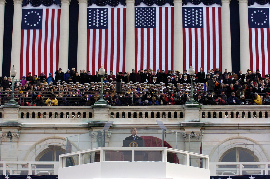 US President George W. Bush presents his inaugural address before a crowd of thousands in Washington, D.C. More than 5,000 men and women in uniform participated in the inaugural events. Military ceremonial support traditionally includes musical units, marching bands, color guards, firing details and salute batteries. Military support of the presidential inauguration is a tradition that reaches back to 1789 when US President George Washington was escorted by members of the US Army to his swearing-in ceremony at Federal Hall in New York City