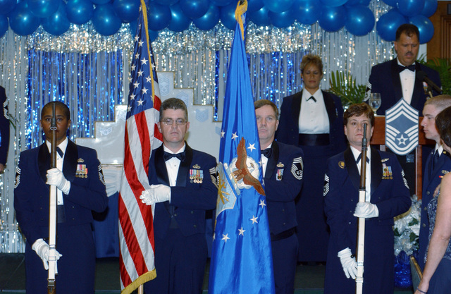 An Honor Guard comprised of U.S. Air Force CHIEF MASTER Sgts. Sandy Ware, Dave Sousa, Mike Gasque and Rebecca Pugsley, present the colors during the CHIEF Induction Dinner at the Tradewinds Enlisted Club, Hickam Air Force Base, Hawaii, on Jan. 21, 2005. (U.S. Air Force PHOTO by Angela Elbern, CIV.) (Released) at the Tradewinds Enlisted Club, Hickam Air Force Base, Hawaii, on Jan. 21, 2005. (U.S. Air Force PHOTO by Ms. Angela Elbern) (Released)