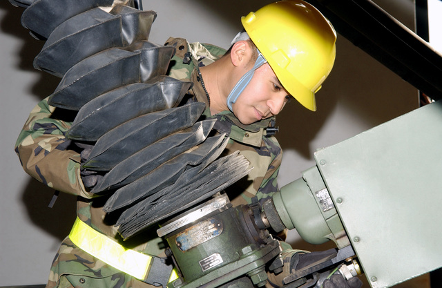 U.S. Air Force 1ST Combat Communication Squadron, satellite, wideband and telemetry systems journeyman SENIOR AIRMAN Efran Garcia, inspects a satellite antenna at Ramstein Air Base, Germany, on Jan. 21, 2005. (U.S. Air Force PHOTO by STAFF SGT. Shannon Kluge) (Released)