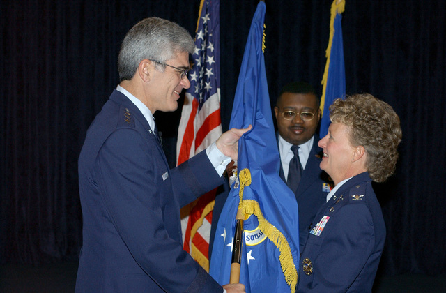 U.S. Air Force Air University Commander, LT. GEN. John Regni, gives the Squadron Officer College's unit flag to COL. Barbara Faulkenberry during the assumption of command ceremony at Maxwell Air Force Base, Ala., on Jan. 21, 2005. (U.S. Air Force PHOTO by Ms. Donna Burnett) (Released)