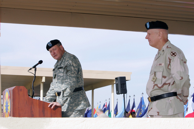 U.S. Army MAJ. GEN. James E. Simmons, Deputy Commanding General of III Corps and Reviewing Officer for the ceremony delivers remarks to a crowd, while Brig. GEN. James E. Chambers, Commanding General of the 13th Corps Support Command listens, during the official Uncasing Ceremony held for the 13th Corps Support Command, on its return from a deployment to Iraq in support of Operation Iraqi Freedom. (U.S. Army PHOTO by John Byerly, CIV) (Released)