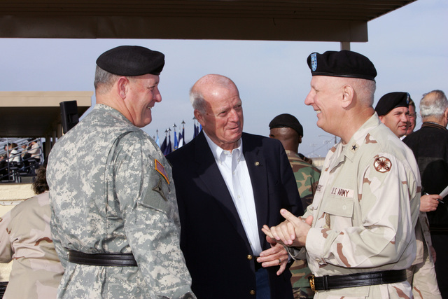 U.S. Army MAJ. GEN. James E. Simmons (left), Deputy Commanding GEN. of III Corps, Mr. Terry Tuggle, President of the Fort Hood National Bank and Brig. GEN. James E. Chambers, Commanding General 13th Corps Support Command, converse prior to the 13th Corps Support Command, Uncasing Ceremony.  The ceremony officially marked the return of the 13th Corps Support Command to Fort Hood, Texas, following its deployment to Iraq in support of Operation Iraqi Freedom. (U.S. Army PHOTO by John Byerly, CIV) (Released)