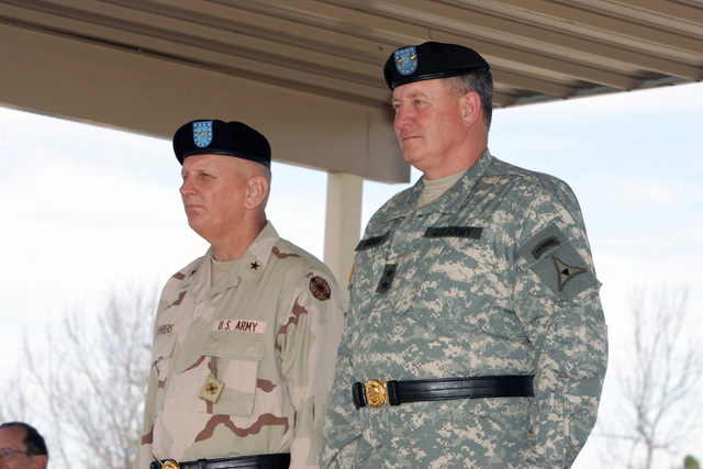 U.S. Army MAJ. GEN. James E. Simmons (right), Deputy Commanding GEN. of III Corps and Brig. GEN. James E. Chambers, Commanding General 13th Corps Support Command, review the 13th Corps Support Command Uncasing Ceremony.  The ceremony officially marked the return of the 13th Corps Support Command to Fort Hood, Texas, following its deployment to Iraq in support of Operation Iraqi Freedom. (U.S. Army PHOTO by John Byerly, CIV) (Released)
