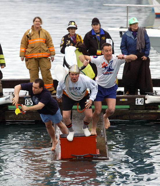 Three U.S. Air Force Airmen of the Band of the Pacific, TECH. SGT. Sam Cliff, MASTER SGT. Jeffrey Manley and TECH. SGT. Jay Nordeen, jump into the icy waters during the 22nd Annual Seward Polar Bear Jump of Resurrection Bay in Seward, Alaska, on Jan. 22, 2005.(U.S. Air Force PHOTO by TECH. SGT. Keith Brown) (Released)