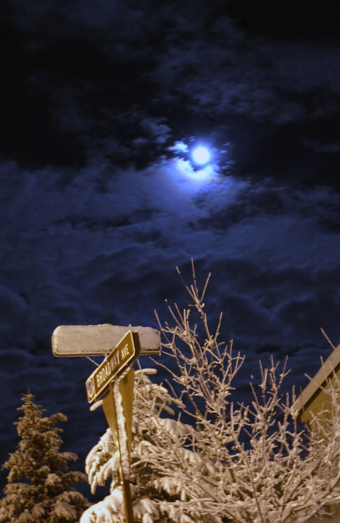 The moon shines bright from a street corner in base housing at Eielson Air Force Base, Alaska, on Jan 24, 2005. (U.S. Air Force PHOTO by SENIOR AIRMAN Christopher Kiser) (Released)