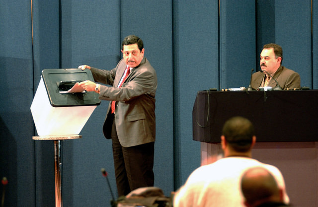 Members of the Iraqi Elections Board of Commissions Dr. Farid Ayar (left), and Mr. Ez Al Deem Al Mohammady (right), hold a press conference at the convention center in Baghdad, Iraq, on Jan. 25, 2005, during Operation Iraqi Freedom. (U.S. Air Force PHOTO by MASTER SGT. Dave Ahlschwede)  (Released)