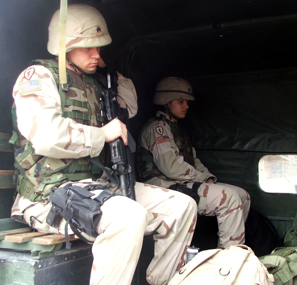 U S  Army 13th Military Police Company prepare to depart in a truck