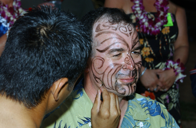 New Hampshire Air National Guard157th Air Refueling Wing Mission Support Group Deputy Commander LT. COL. Dennis Hebert receives a temporary traditional face tattoo at Paradise Cove, Hawaii, on Jan. 26, 2005.(U. S. Air Force PHOTO by STAFF SGT. Dawn Finniss) (Released)