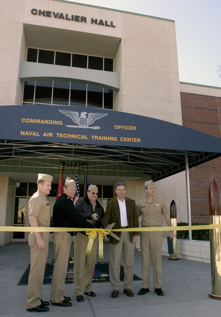 US Navy (USN) Captain (CAPT) Gerald Manley (left), Naval Facility Regional Officer in Charge (OIC) of Construction; USN CAPT Lloyd Callis, Commanding Officer (CO) Naval Air Technical Training Center (NATTC); USN CAPT John Pruitt, CO, Naval Air Station Pensacola (NASP); John Bennett, Broadmoor LLC; and CAPT Robert Raines (right), Naval Facility Southern Division, cut the ceremonial ribbon at Chevalier Hall on board NAS Pensacola, Florida (FL). Chevalier Hall, rebuilt after being devastated with heavy damage from Hurricane Ivan in September 2004, is the home of aviation technical schools where new Sailors receive their initial training before being assigned to the Fleet