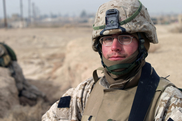 A US Marine Corps (USMC) Marine assigned to Kilo Company, 3rd Battalion, 8th Marines, provides security at a polling site for the upcoming Iraqi elections, in Nasarwasalam, Iraq. The 1ST Marine Division is engaged in Security and Stabilization Operations (SASO), in the Al Anbar Province, Iraq, in support of Operation IRAQI FREEDOM