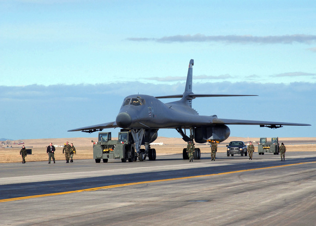 U.S. Air Force maintenance Airmen, from the 28th Bomb Wing, Ellsworth Air Force Base, S.D., move a 1983 model B-1B Lancer aircraft, from the 77th Bomb Squadron, to the South Dakota Air&Space Museum, located just outside the main gate of the base, on Feb. 1, 2005. The Airmen removed all of the aircraft's primary systems and parts for use in the Wing's active B-1B force before moving it to the museum. (U.S. Air Force PHOTO by STAFF SGT Joanna E. Hensley) (Released)