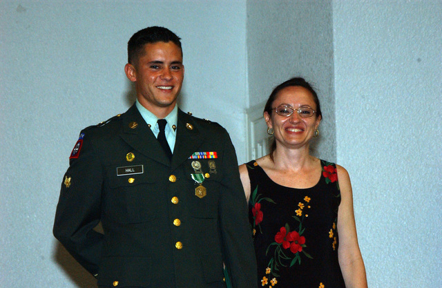 U.S. Army Garrison Soldier of the Year, SPC. Johnny Hall, with his mother posing for the camera during the Celebration Ceremony for Soldier and Noncommissioned Officer of the Year in the Community Club at Fort Buchanan. (U.S. Army photo by Marcos Orengo) (Released)