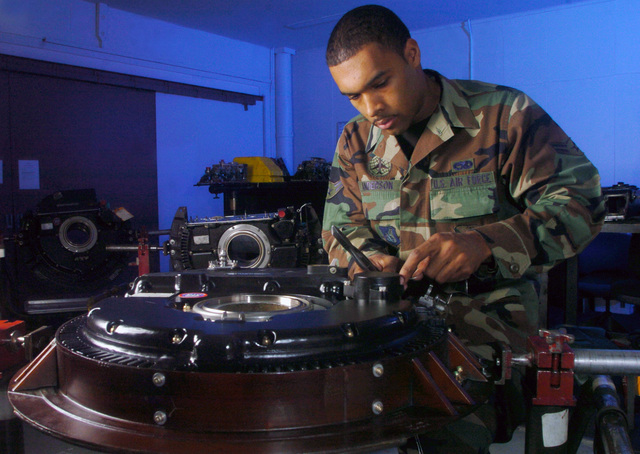 U.S. Air Force AIRMAN 1ST Class Willie Anderson, an aircraft mechanic from the 374th Maintenance Squadron, T56 Engine Regional Repair Center, installs a lead cover on a C-130 Hercules cargo aircraft propeller assembly pump housing unit at Yokota Air Base, Japan, on Feb. 2, 2005. The center handles all C-130 repair in Pacific Air Forces. Their mission is to provide ready engine and propeller support to guarantee U.S. airlift and Special Operations presence and crisis response in the region. (U.S. Air Force PHOTO by MASTER SGT. Val Gempis) (Released)