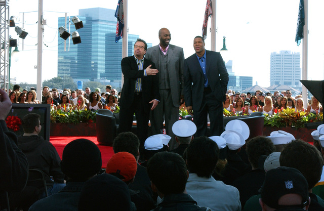 "Fox Sports televison show hosts Tom Arnold (left), John Sally (center), and Michael Strahand, address the audience during the taping of""The Best Darn Sports Show Ever, Period""during SUPERBOWL XXXVIV at Jacksonville, Fla., on Feb. 4, 2005. The show that gave free tickets to military personnel. (U.S. Air Force PHOTO by MASTER SGT. Shaun Withers) (Released)"