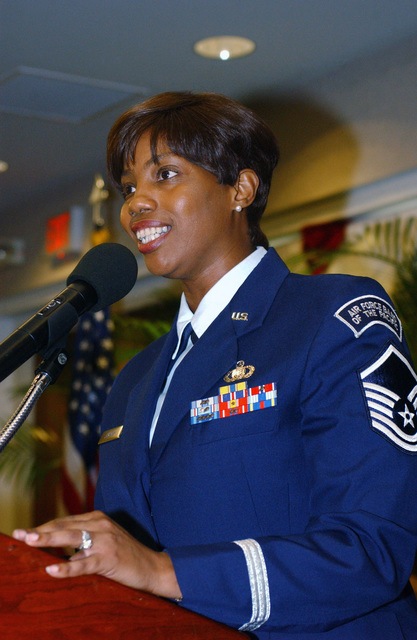 """U.S. Air Force MASTER SGT. Debra Jamison leads attendees of the Black History Month Luncheon in singing""""Lift Every Voice and Sing""""at the Tradewinds Enlisted Club at Hickam Air Force Base, Hawaii, on Feb. 4, 2005. (PHOTO by Angela Elbern, CIV) (Released)"""