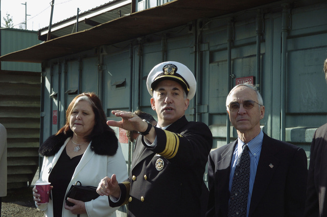 US Navy Rear Admiral, Upper Half (RADM) Jay M. Cohen (center), CHIEF of Naval Research, conducts a tour of the USN Fast Ship Frame Class, USS SEA FIGHTER (FSF 1), formerly the USN Littoral (near-shore waters) Surface Craft-Experimental (LSC-X), for Mrs. Lynn Hunter (left), the ships sponsor, and the Honorable Mr. Gordon R. England, the Secretary of the Navy (SECNAV). The SEA FIGHTER is moored to the dock at the Nichols Brothers Boat Builders Shipyard, Freeland, Whidbey Island, Washington (WA), and will used to evaluate the hydrodynamic performance, structural behavior, mission flexibility, and the propulsion systems of high-speed catamaran style vessels