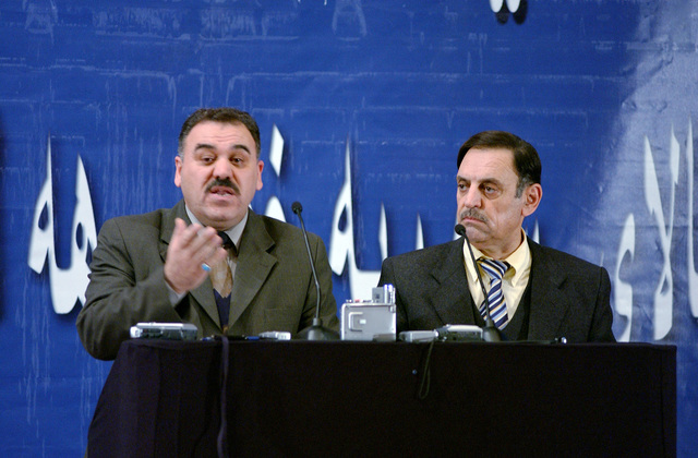 Two Iraqi electoral commissioners give a partial update of the results of ballot counting for the first Iraqi elections during a press briefing at the Green Zone, Baghdad, Iraq, on Feb. 7, 2005. (U.S. Air Force PHOTO by STAFF SGT. Angelique Perez) (Released)