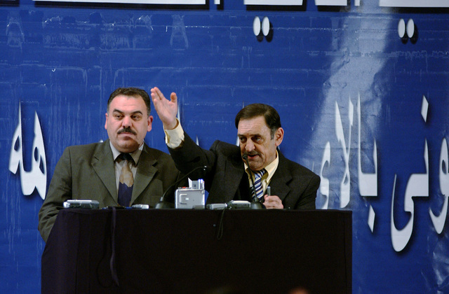Two Iraqi electoral commissioners take questions from the audience while they give a partial update of the results of ballot counting for the first Iraqi elections during a press briefing at the Green Zone, Baghdad, Iraq, on Feb. 7, 2005. (U.S. Air Force PHOTO by STAFF SGT. Angelique Perez) (Released)