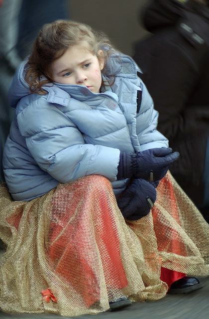 "A young girl sits and waits for the local Fasching Parade to begin at Ramstein Village, Germany, on Feb. 8, 2005. The parade was initially named and reserved for the Tuesday Eve before Ash Wednesday.""Fastnacht""was the last celebration before the lean and somber time of Lent. (U.S. Air Force PHOTO by AIRMAN Laura Simi) (Released)"