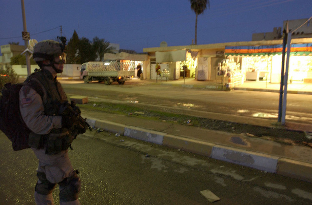 U.S. Army PFC. Daniel Callen, from Charlie Troop, 1ST Squadron, 4th Calvary Regiment, 1ST Infantry Divison, patrols the streets of Poliwoda, Balad, Iraq, on Feb. 8, 2005. When elections where held in this city no one voted because the civic leader building was bombed and there where protests against the Iraqi government. (U.S. Air Force PHOTO by AIRMAN 1ST Class Kurt Gibbons III) (Released)