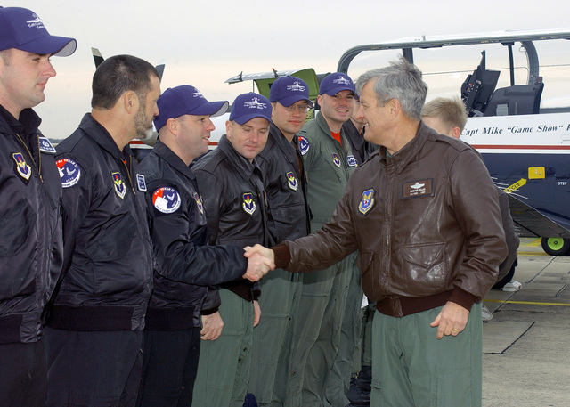 U.S. Air Force MAJ. GEN. Edward R. Ellis (right), Commander of the 19th Air Force, congratulates members of the East Coast T-6 Texan II aircraft demonstration team following their certification flight at Randolph Air Force Base, Texas. on Feb. 9, 2005. (DOD PHOTO by David Terry) (Released)