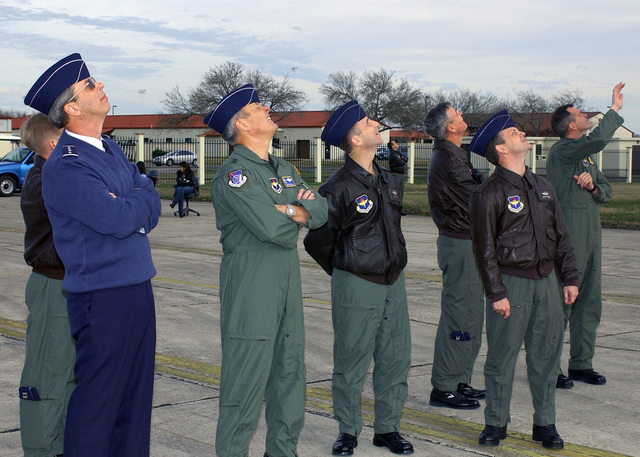 (From-left-to-right), U.S. Air Force GEN. Donald Cook, Commander of the Air Education and Training Command, MAJ. GEN. Edward R. Ellis, Commander of 19th Air Force, COL. Tony Lazarski, Commander of the 479th Flying Training Group, Moody Air Force Base, Ga., COL. John F. Newell, Commander of the 12th Operations Group, and COL. John W. Hesterman III, Commander of the 12th Flying Training Wing, watch as a U.S. Air Force T-6 Texan II aircraft perform aerial maneuvers during a certification flight at Randolph Air Force Base, Texas, on February 10, 2005. (DOD PHOTO by David Terry) (Released)