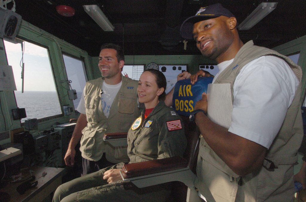 US Navy (USN) Lieutenant (LT) Allison Johnson (center), poses with New York Giants Quarterback Kurt Warner (left), and Wide Receiver Amani Toomer during their visit aboard the Military Sealift Command (MSC) Hospital Ship USNS MERCY (T-AH 19). The MERCY is currently off the waters of Indonesia in support of Operation UNIFIED ASSISTANCE the humanitarian relief effort to aid the victims of the Tsunami that struck Southeast Asia on December 26, 2004. (SUBSTANDARD)