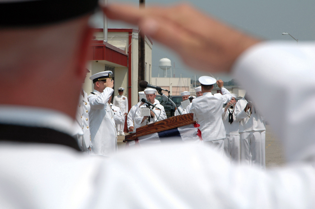 US Navy (USN) Sailors render honors as USN Musicians salute the Colors during the establishment of Riverine Group 1 at Naval Amphibious Base Little (NAB) Creek, Virginia (VA). The unit is just one part of the newly created Navy Expeditionary Combat Command (NECC). NECC integrates for the first time war-fighting requirements for expeditionary combat and combat supply elements. It transforms Navy forces to make them more capable, responsive and effective in their role in the global war on terrorism. NECC is building a continuum of capabilities that are unique to the expeditionary maritime environment