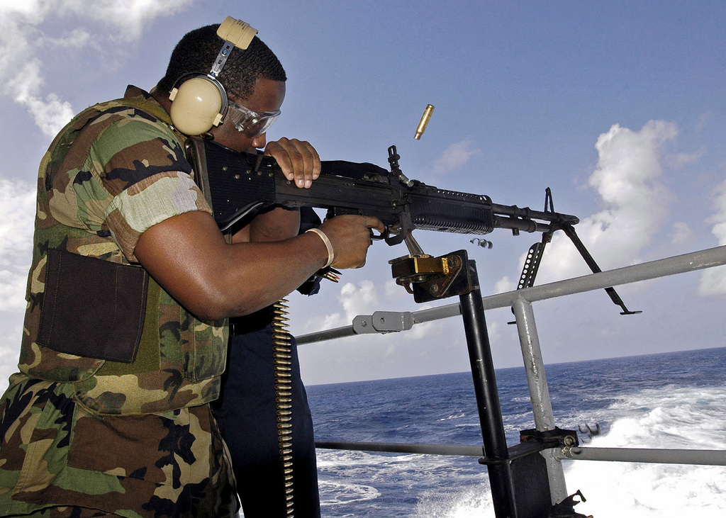 US Navy (USN) MASTER-at-Arms Second Class (MA2) Kenneth Akers fires a 7.62 mm general purpose machine gun onboard the Nimitz Class Aircraft Carrier, USS ABRAHAM LINCOLN (CVN 72) in order to hone his marksmanship skills during a small arms live-fire weapons familiarization exercise