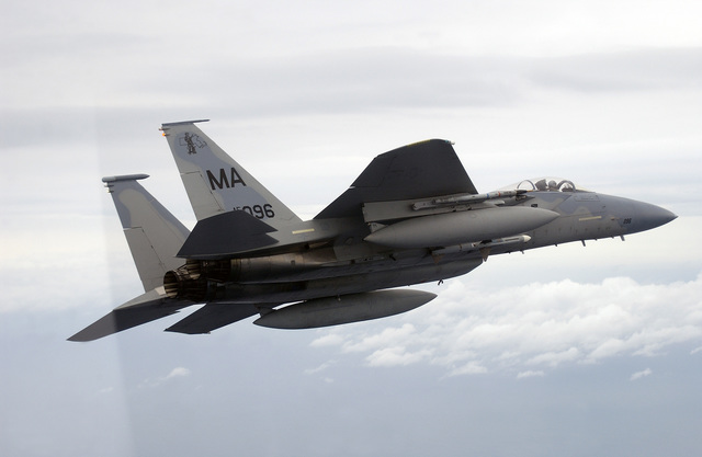 A Massachusetts Air National Guard F-15 Eagle aircraft from the 101st Fighter Squadron, Otis Air National Guard Base, Mass., prepares to fire an AIM-120 Advanced Medium Range Air-to-Air Missile (AMRAAM) over the Gulf of Mexico during a Combat Archer weapons evaluation mission on Feb. 24, 2005. (U.S. Air Force PHOTO by MASTER SGT. Michael Ammons) (Released)