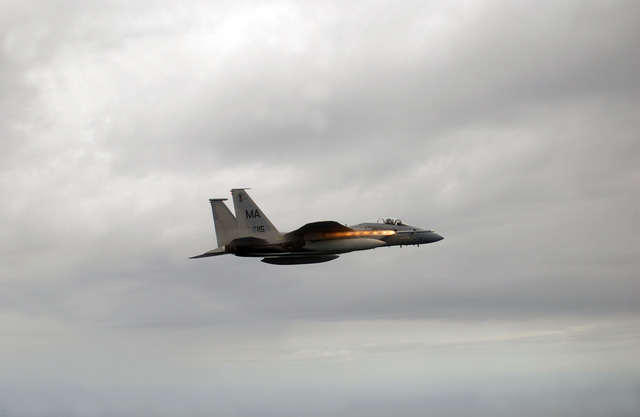 A Massachusetts Air National Guard F-15 Eagle aircraft from the 101st Fighter Squadron, Otis Air National Guard Base, Mass., fires an AIM-120 Advanced Medium Range Air-to-Air Missile (AMRAAM) over the Gulf of Mexico during a Combat Archer weapons evaluation mission on Feb. 24, 2005. (U.S. Air Force PHOTO by MASTER SGT. Michael Ammons) (Released)