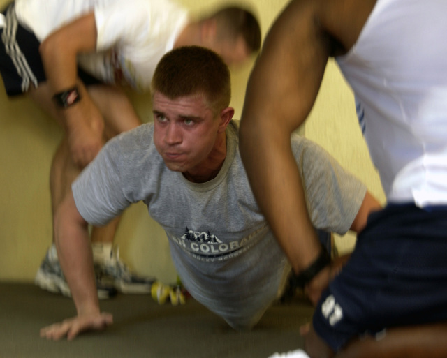 U.S. Air Force 2nd LT. Jonathen Searles, of 36th Commucations Squadron, pushes out a few more push-ups before his time is up during the Fit to Fight portion of the Team Andersen Challenge at Andersen Air Force Base, Guam, on Feb. 25, 2005. (U.S. Air Force PHOTO by AIRMAN Teresa M. Pumphrey) (Released)