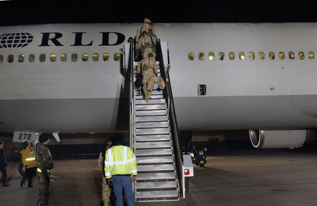 U.S. Army Soldiers, assigned to the 173rd Airborne Brigade Combat Team, Caserma Ederle, Vincenza, Italy, board a World Airways MD-11 aircraft at Aviano Air Base, Italy, on Feb. 25, 2005. The Soldiers are leaving for an Operation Enduring Freedom deployment to Bagram Air Field, Afghanistan. (U.S. Air Force PHOTO by AIRMAN 1ST Class) (Released)