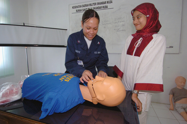 US Navy (USN) Hospital Corpsman Third Class (HM3) Lynette Shute, from the Military Sealift Command (MSC) Hospital Ship USNS MERCY (T-AH-19) [not shown], instructs Indonesian a civilian Nurse on cardiopulmonary resuscitation (CPR) at Tentera Nasional Indonesia Military Hospital in Banda Aceh, Indonesia. The MERCY is currently off the waters of Indonesia in support of Operation UNIFIED ASSISTANCE the humanitarian relief effort to aid the victims of the Tsunami that struck Southeast Asia on December 26, 2004