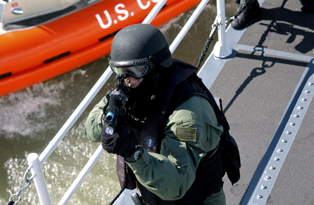 U.S. Coast Guard PETTY Officer 1ST Class Michael Abel of Marine Safety and Security Team keeps close watch of the bridge aboard the Marine Protector Class Coastal Patrol Boat USCG TERN  (WPB-87343) during a Special Surface and Airborne Use of Force exercise in the Pacific Ocean, Mar. 6, 2007. (USCG photo by PA1 Alan Haraf) (Released)