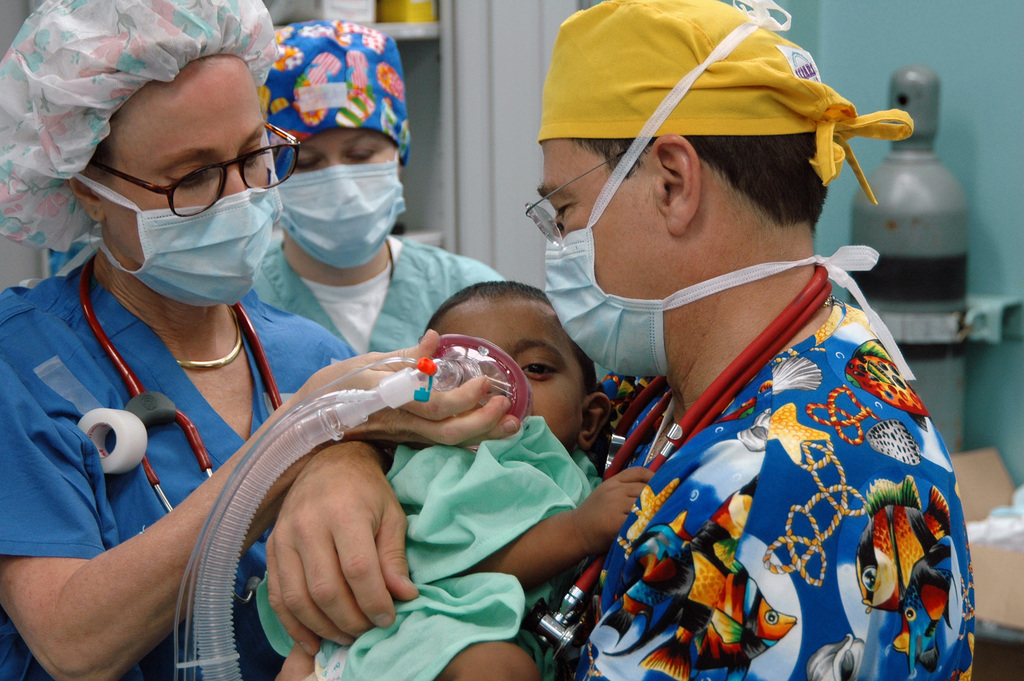 Onboard the US Navy (USN) Military Sealift Command (MSC), Hospital Ship, USNS MERCY (T-AH 19), Operation Smile volunteers Janet Casabon Benowitz (left) and Dr. Bill Pond, anesthetize a young Bengali child before the child undergoes corrective plastic surgery on his cleft lip. The MERCY is anchored off the coast of Chittagong, Bangladesh, while on a scheduled five-month deployment to deliver aid and humanitarian assistance to South and Southeast Asia and the Pacific Islands