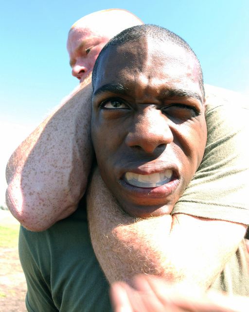 US Marine Corps (USMC) Recruits from 1ST Battalion demonstrate the proper technique for a figure four choke hold while participating in the first phase of their Marine Corps Martial Arts Program (MCMAP) training, held aboard Marine Corps Recruit Depot (MCRD), Parris Island, South Carolina (SC)