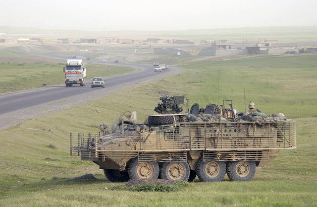 A US Army (USA) M1126 Stryker Infantry Carrier Vehicle (ICV) with Slat Armor cage from the 2nd Platoon (PLT), Bravo (B) Company (CO), 1ST Battalion (BN), 5th Infantry (INF), 25th Infantry Division (ID) (Stryker Brigade Combat Team (SBCT)), in position while on patrol near Mosul, Iraq. The cage detonates anti-tank shaped charges away from the vehicle. The SBCT is assigned to Task Force Freedom supporting Operation IRAQI FREEDOM