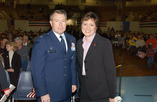 "U.S. Air Force COL Bryan Benson, Commander of the 71st Flying Training Wing, Vance Air Force Base, Okla., poses for a photograph with Deputy Assistant Secretary of Defense Allison Barber during the""America Supports You""rally at the Mark Price Arena at Enid, Okla., on April 1, 2005. Enid is the first town in Americato not only partner with America Supports You, but to build a support program for military men and women. (PHOTO by Terry Watson, CIV) (Released)"