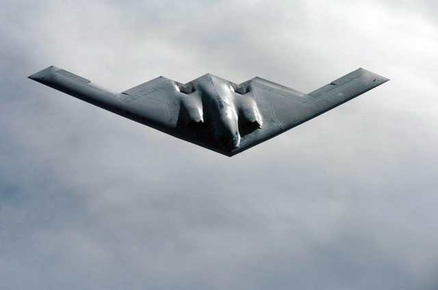 A U.S. Air Force B-2 Spirit bomber aircraft from the 509th Bomber Wing, Whiteman Air Force Base, Mo., soars over the Pacific Ocean during a refueling mission on April 4, 2005. The 509th BW is currently deployed at Andersen Air Force Base, Guam. (U.S. Air Force PHOTO by MASTER SGT. Val Gempis) (Released)