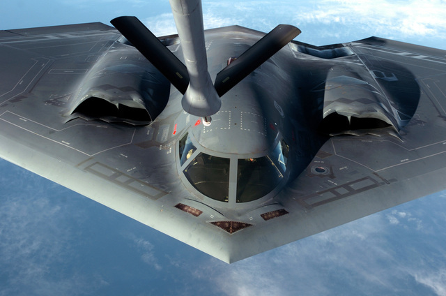 "A U.S. Air Force B-2 Spirit""Stealth""bomber, 509th Bomber Wing, Whiteman Air Force Base, Mo., approaches the aerial refueling boom of a KC-135 Stratotanker, somewhere over Guam, Apr. 4, 2005.  The Bombers are deployed to Anderson Air Force Base, Guam, as part of a rotation that has provided the U.S. Pacific Command a continous bomber presence in the Asian Pacific region since February 2004, enhancing regional security and the U.S. commitment to the Western Pacific. (U.S. Air Force photo by MASTER SGT. Val Gempis) (Released)"