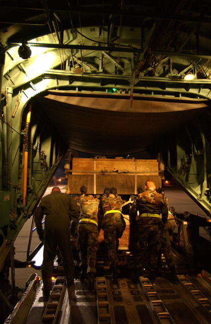 U.S. Air Force Airmen, from the 43rd Airlift Squadron, load 40,000 pounds of cargo and equipment at night on a C-130 Hercules cargo aircraft during the Joint Force Entry Exercise (JFEX) at Pope Air Force Base, N.C., on April 4, 2005. JFEX is a joint airdrop training designed to enhance service cohesiveness between U.S. Army and Air Force personnel. (U.S. Air Force PHOTO by STAFF SGT. James Harper) (Released)